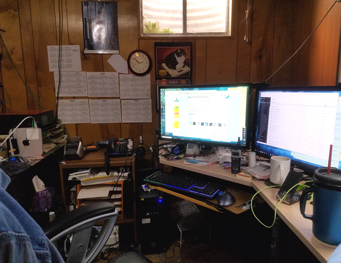 places I write - photo of cluttered desk in basement