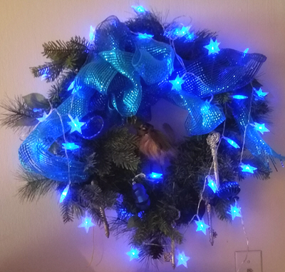 Geeky Fairy Light Addiction - holiday wreath with blue star-shaped lights