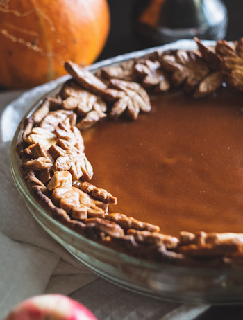 picture of a pumpkin pie with crust decorations, another of the three recipes for gatherings