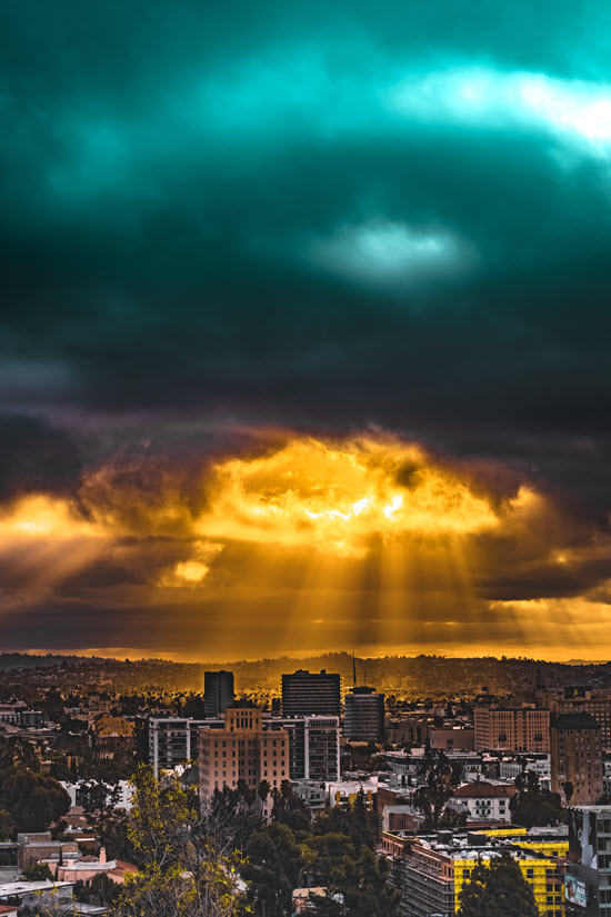 Sunset and rain clouds over a cityscape