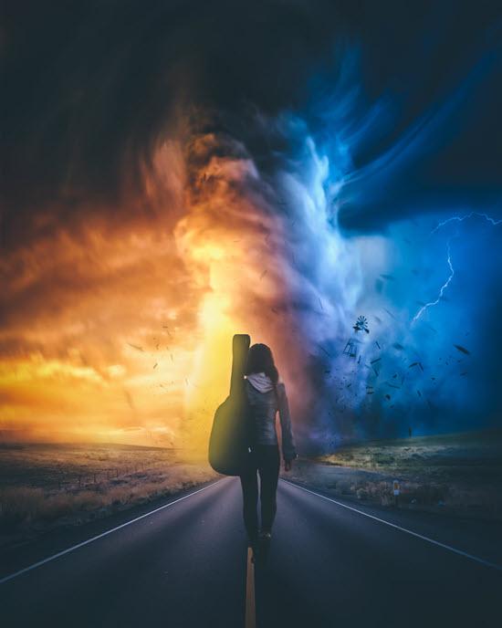 Girl carrying a guitar and walking toward a tornado touching down
